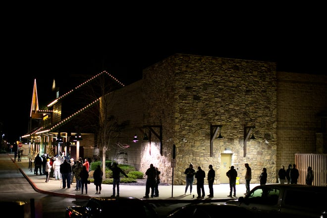 People wait for Cabela's to open Friday morning. Fewer than 100 people were in line when the store opened at 5 a.m.