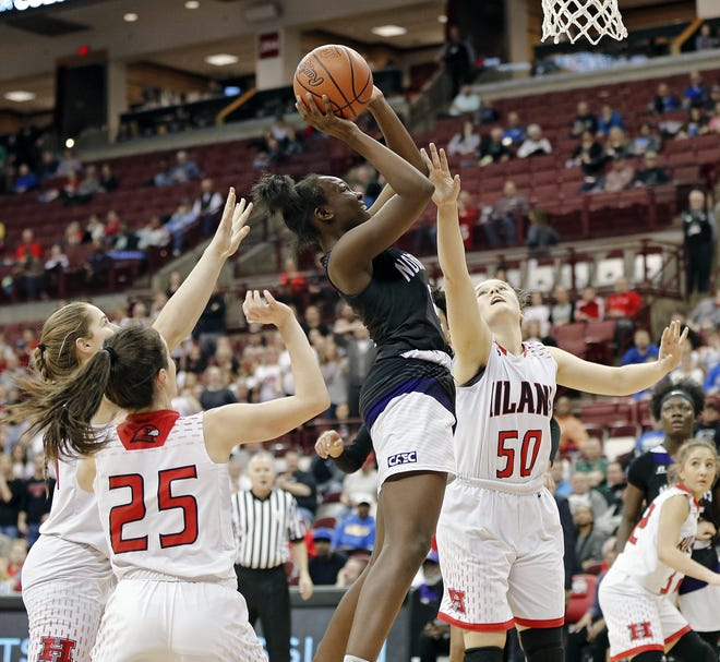 Africentric's Arianna Smith, an Indiana State signee, puts up a shot against Berlin Hiland during a Division III state semifinal in March 2019.