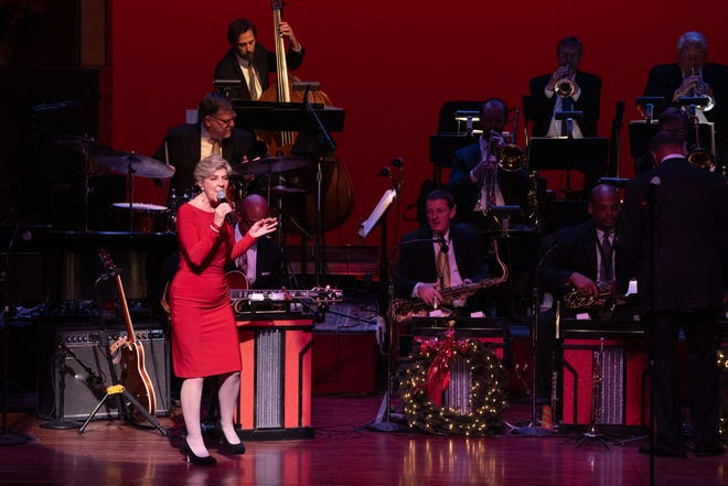 "Kelly Crum Delaveris performing during the ""Home for the Holidays"" program in 2015."