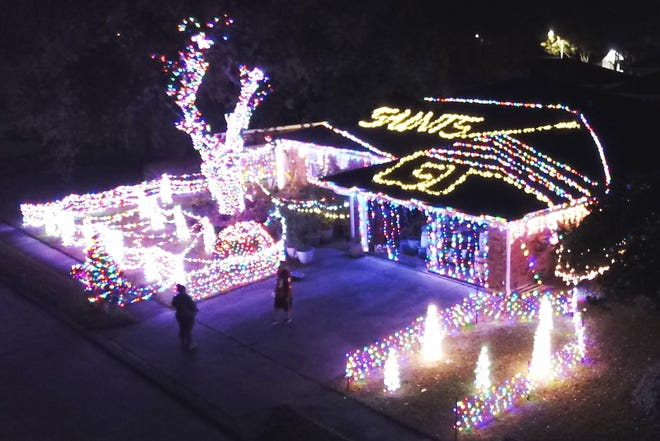 Bill Sieben shows his support for the New Orleans Saints in his Christmas light display last December at his home, 210 Midland Drive in Houma. He said his display has grown each year since 2017 and is now up to more than 40,000 lights.