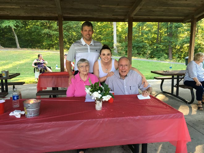 Drew and Laura Haywood pose in happier times with Drew's grandparents, Gene Booker and his wife Bobbie Jean.