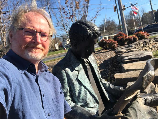 'I'll miss you, brother.' Me sitting with the newspaper reader statue at the Gateway Park outside of The Courier-Tribune's office in Asheboro.