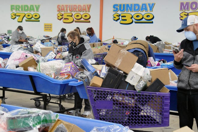 At least 100 people were in line at Dollar1, a discount store on Portage Road, before it opened at 5 a.m. to Black Friday shoppers.