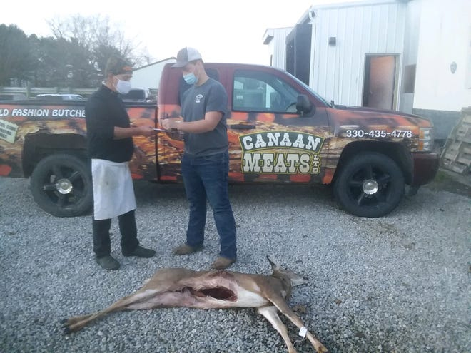 Austin Wilhelm (right), a junior at Northwestern High School, donates a deer he recently shot with a bow to the Farmers and Hunters Feeding the Hungry program. Accepting the donation is Canaan Meats co-owner Tim Morris. The program benefits over 20 food banks and food pantries in Wayne and Holmes counties.