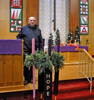 The Rev. Kevan Franklin in the sanctuary of the Trinity United Church of Christ in Wooster. Franklin, who is the senior minister at the church, helps serve breakfast every weekday.