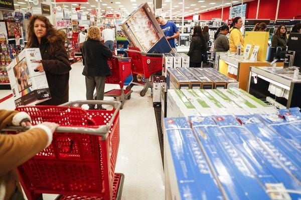 Crowds of shoppers, like these, are were ghosts of the past, with new online and more traditional in-person Black Friday deals this year.
