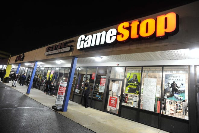 People waited in line at GameStop at 715 Crescent St. in Brockton on Black Friday on Nov. 27, 2020. They were waiting to buy the new Sony PS5 and Xbox Series X.