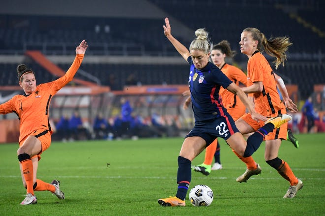 United States Kristie Mewis, number 22, scores her side's second goal during the international friendly women's soccer match between The Netherlands and the US at the Rat Verlegh stadium in Breda, southern Netherlands, Friday Nov. 27, 2020.