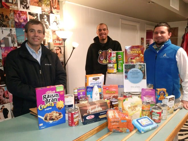 As part of Alfred State's fifth annual Day of Giving, the Institutional Advancement Office collected nonperishable and personal care items to help replenish the on-campus food pantry. Pictured, from left to right, are Jonathan Hilsher, director of the Center for Civic Engagement; Jovannie Igartua, a student and civic engagement advocate; and Jason Sciotti, director of Development.