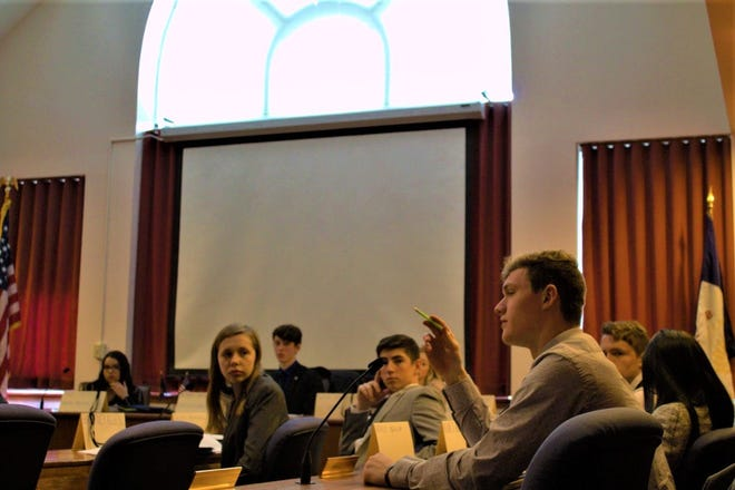 Students debate issues during a 2019 simulated legislative session.