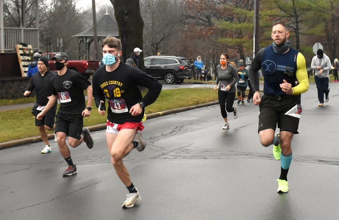 Trevor Dzikowicz (43) and Matt Wright (right) started side-by side and finished one-two at Little Falls' Thanksgiving morning Turkey Trot.