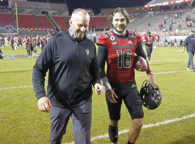 North Carolina State coach Dave Doeren laughs with quarterback Bailey Hockman (16) after the team's 38-22 victory over Florida State Nov. 14.