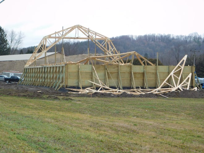 The trusses on a salt and sand storage barn that was under construction at the Newport Town Highway Department collapsed late Friday morning, injuring two workers.