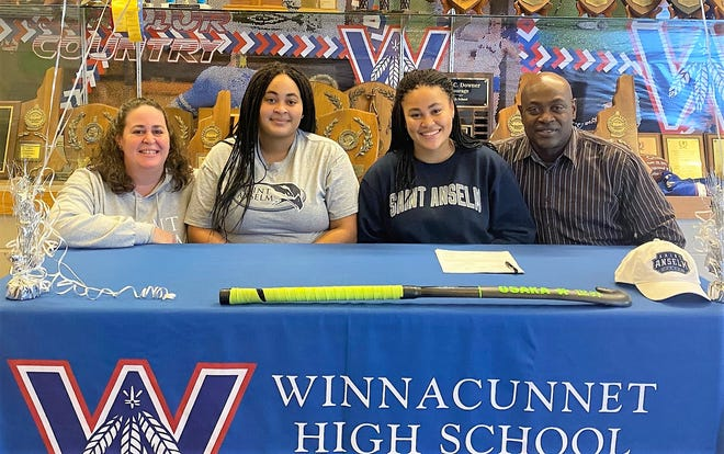Winnacunnet High School senior Grace Michael, third from left, signed her National Letter of Intent on Tuesday to play field hockey at Saint Anselm College. Grace was joined at her signing by, from left, her mother, Kim, her sister, Hannah, and her father, Paul.