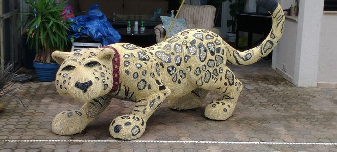Artist Amy Stump scrubbed and media blasted Diamonds and Purrls, then replaced missing beads to restore the Big Cat.