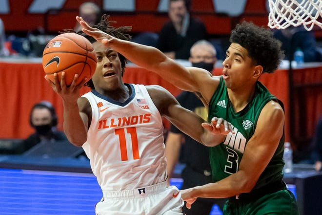 Nov 27, 2020; Champaign, Illinois, USA; Illinois Fighting Illini guard Ayo Dosunmu (11) goes up for a shot against Ohio Bobcats forward Ben Roderick (3) during the first half at the State Farm Center. Mandatory Credit: Patrick Gorski-USA TODAY Sports