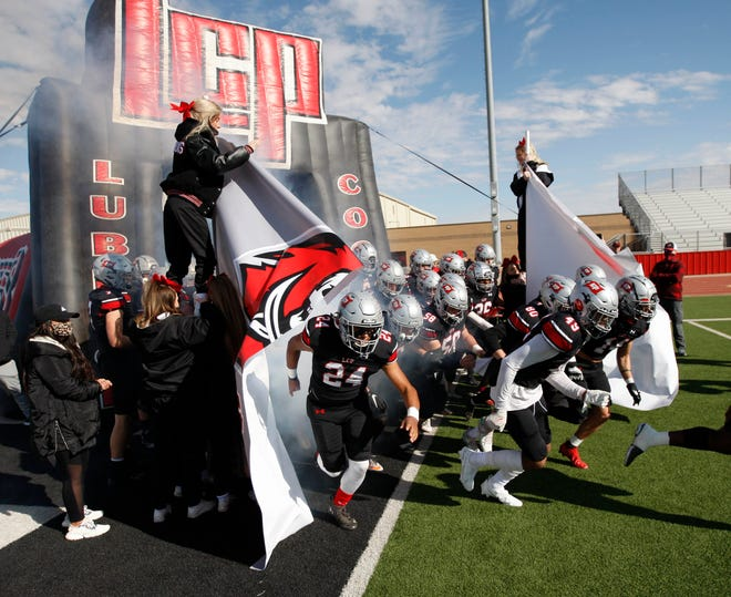 Lubbock Cooper players run onto the field before the start of the game. Lubbock Cooper played Wichita Falls Rider at Pirate Stadium at First United Park Friday, Nov. 27, 2020. (Mark Rogers/For A-J Media)