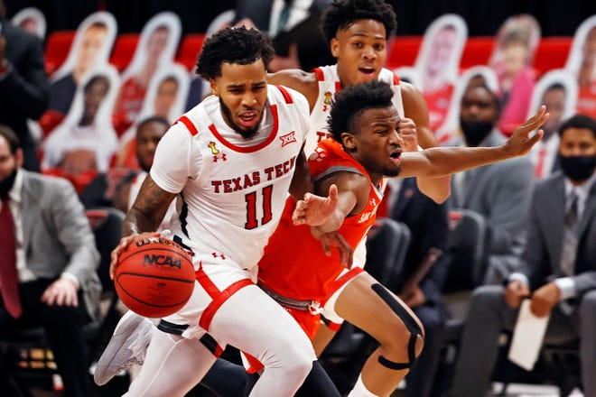 Texas Tech's Kyler Edwards (11) dribbles the ball past Sam Houston State's Bryce Monroe (0) during the first half of a nonconference game Friday at United Supermarkets Arena. Edwards finished with nine points as the No. 14 Red Raiders downed the Bearkats 84-52.