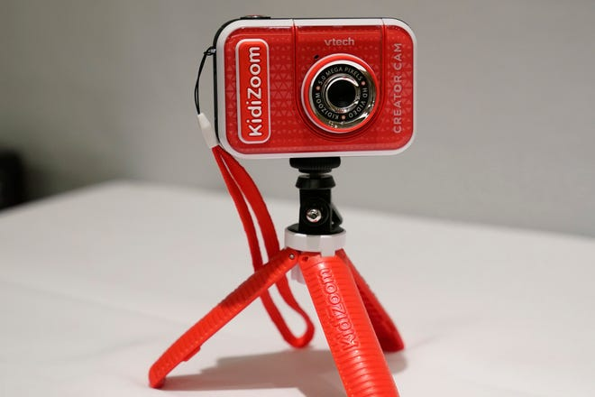 A KidiZoom Creator Cam by VTech is displayed at the Toy Fair, on Sept. 17, in New York. The digital camera comes with a green screen and animated backgrounds allowing kids to go to outer space, get chased by T-Rex, or make things disappear. The camera comes with a tabletop tripod, which can also be used as a selfie stick.