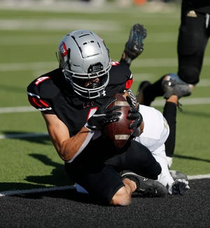 Lubbock Cooper's Rylan Wilson (4) scores a touchdown in the first half. Lubbock Cooper played Wichita Falls Rider at Pirate Stadium at First United Park Friday, Nov. 27, 2020. (Mark Rogers/For A-J Media)