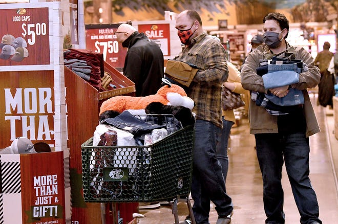 Shoppers get in on the Black Friday sales while shopping at Bass Pro Shops in Foxboro, Mass., on Friday. The outdoor specialty store opened their doors at 5 a.m.