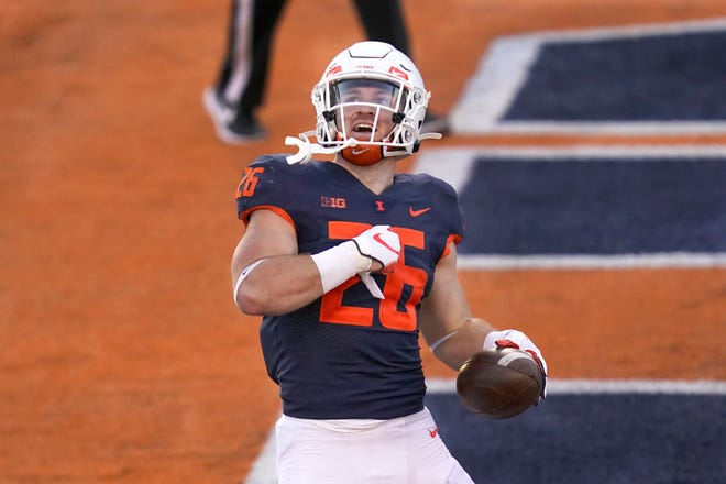 Illinois running back Mike Epstein (26) celebrates after scoring during the first half of an NCAA college football game against Minnesota Saturday, Nov. 7, 2020, in Champaign, Ill. [AP Photo/Charles Rex Arbogast]