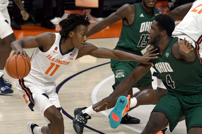 Illinois' Ayo Dosunmu (11) pushes past Ohio's forward Dwight Wilson III (4) during the first half of an NCAA college basketball game Friday, Nov. 27, 2020, in Champaign, Ill. [AP Photo/Holly Hart]