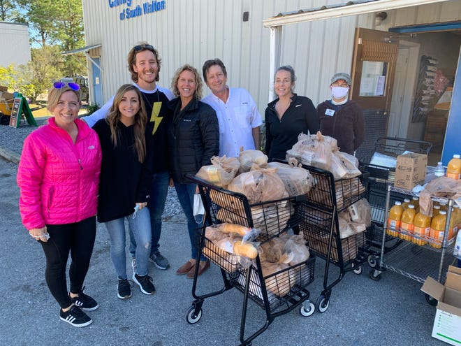 Caring & Sharing of South Walton distributed Thanksgiving meals to more than 360 families in Walton County.