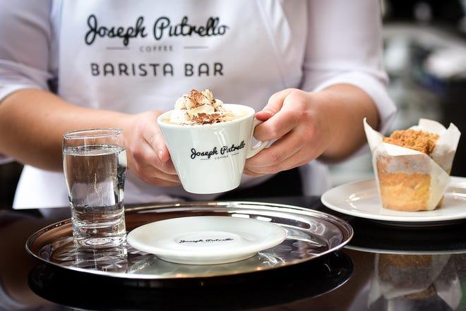 A Vienna coffee is prepared for a customer at Joseph Putrello Coffee Barista Bar on Nov. 24 in Utica.