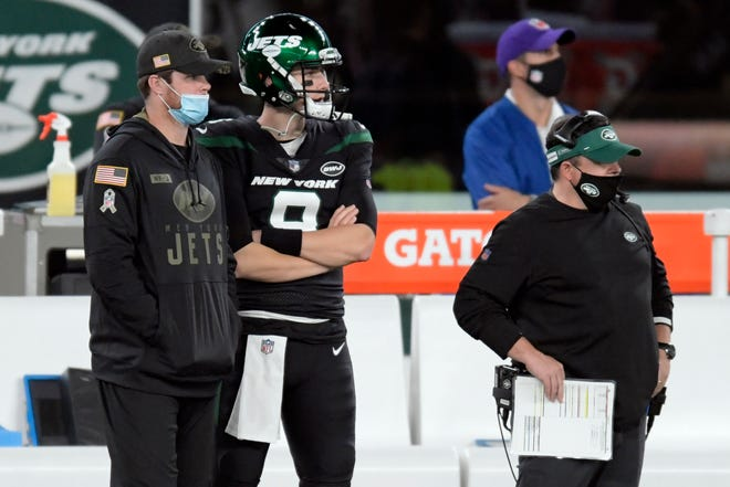 New York Jets quarterback Sam Darnold, left, looks on from the sidelines during a Nov. 9 game. Darnold missed the last two games against New England and the Los Angeles Chargers because of a shoulder injury. Joe Flacco started in his place.