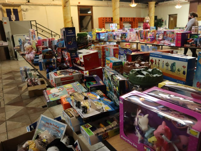 Toys are lined up at on tables at Plymouth Bethesda and Cornerstone Community Church on Friday in Utica.