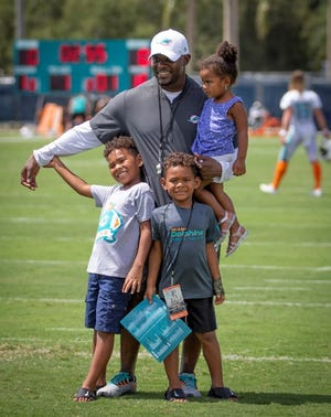 Miami Dolphins coach Brian Flores poses for a photo with his children.