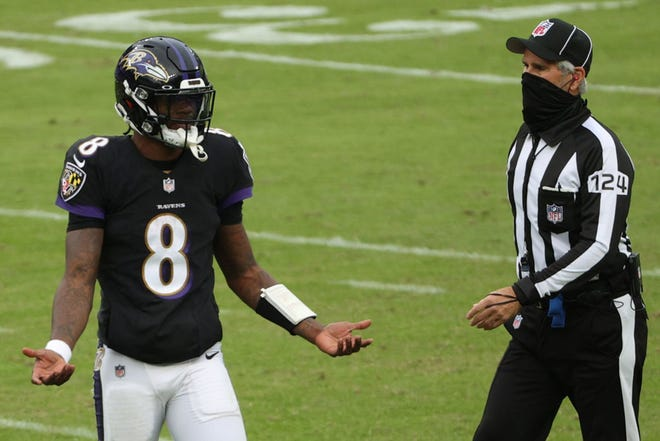 Lamar Jackson, reacting after throwing an interception during last Sunday's game against the Titans, is the biggest NFL star to become infected by COVID-19.