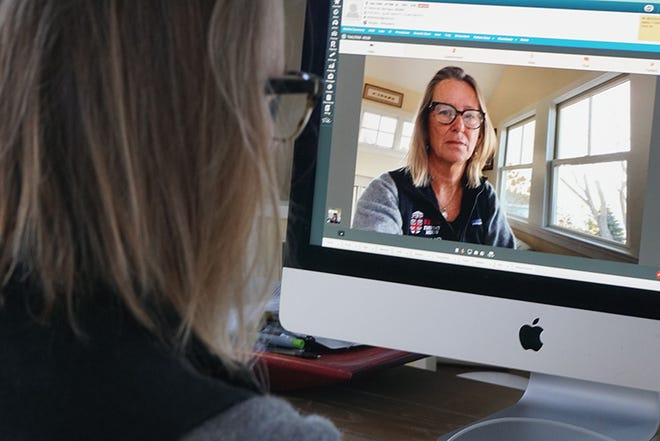 Dr. Susan Duffy, one of the people behind the Brown Emergency Medicine telehealth initiative, demonstrates the program's interface while working at home. [The Providence Journal / Sandor Bodo]