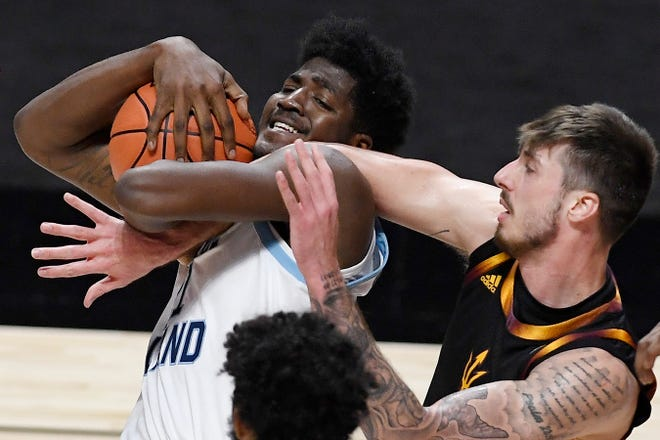 Rhode Island's Makhi Mitchell, left, tangles with Arizona State's Chris Osten in a November 2020 game. Mitchell appears to be back to full speed after a knee injury shortened his 2020-21 season.