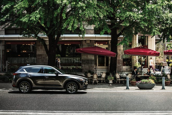 The 2021 Mazda CX-5 offers new features that make driving safer and more fun.