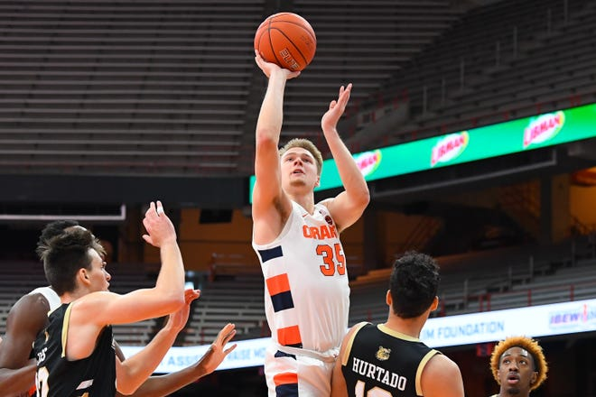 Syracuse Orange guard Buddy Boeheim (35) shoots tagainst the Bryant University during the first half at the Carrier Dome on Friday. Bryant led for much of the game, and lost by one point.