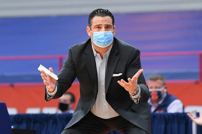 """Bryant coach Jared Grasso, shown in a November gam at Syracuse, said about Sunday's loss, """"We lost to a better team today."""""""