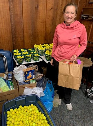 Mary Suitca drops off some of the 275 items golfers at Tannenhauf Golf Club donated for the Alliance Community Pantry.