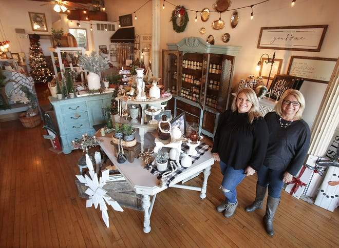 Amy Skiles (left), owner of Charmed Again, opened her home decor and furniture restoration shop on Nov. 13 at 115 Lincoln Way E, Massillon. Skiles' mother, Sue Dragomier, is also pictured and is a shop employee.