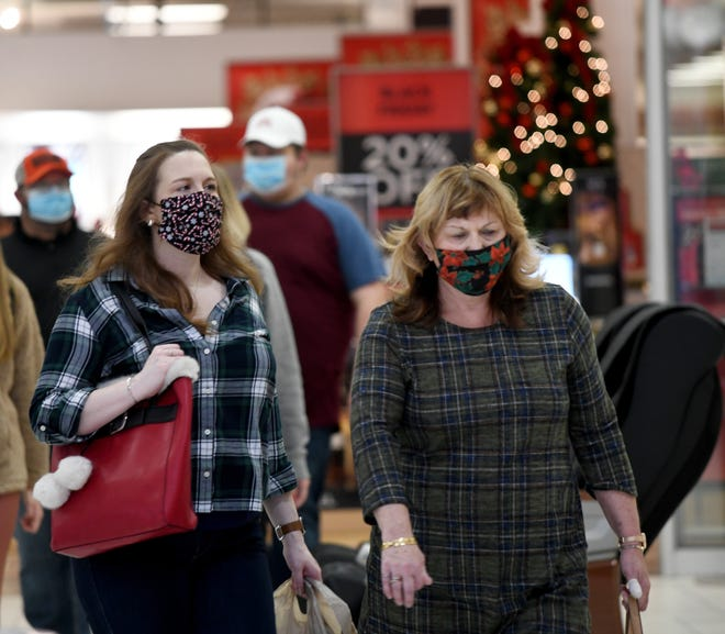 Jilliann Gardner (left) and her mother, Jill Armstrong wear their festive masks on the annual Black Friday outing at Belden Village Mall in Jackson Township.