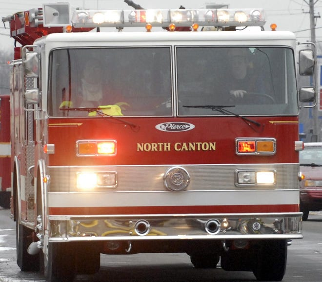 North Canton firefighters drive a fire truck in this undated photo.