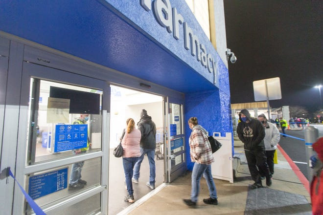 The first Black Friday shoppers enter the store at 5 a.m. at Walmart Supercenter, 3849 Northridge Drive, on Friday in Rockford. The first two people in line said they had only been there since 4:30 a.m. As the couple arrived at the store they saw other shoppers waiting inside their cars in the parking lot. So they got out and got the first spot in line.