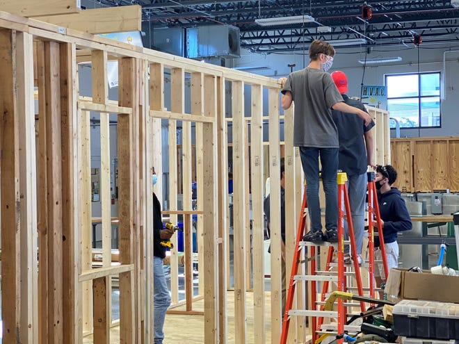 Suncoast Technical College students work inside a tiny home on campus.