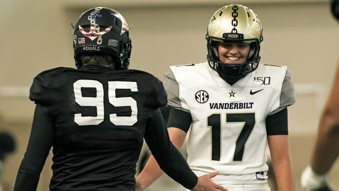 Vanderbilt kicker Sarah Fuller, right, slaps hands with a teammate during Wednesday's practice.