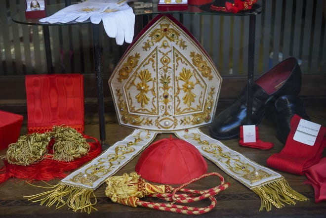 Cardinal clothing accessories are seen on display in the window of the Gammarelli clerical clothing shop Nov. 26 in Rome.