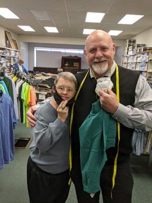 Joe Sugar with a customer at Joe Sugar's of St. Pauls. The store has a second location, Sugar's Menswear Studio, in Fayetteville.