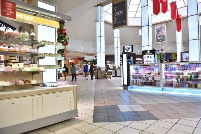 Few shoppers are out at Cross Creek Mall on Friday morning.