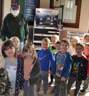 The preschool class gets their picture taken with veteran Mr. Roseberry at the Dennison Post Office.