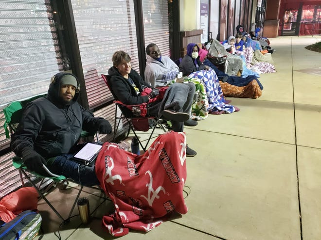 Waiting for a few of the rare Playstation 5 systems, some shoppers outside the Midtown Village Game Stop had camped out since early Wednesday morning. From left to right are Courtney Garrett, Riley Tucker, Kristopher Curry and Antoinette Adam. [Staff photo/Mark Hughes Cobb]
